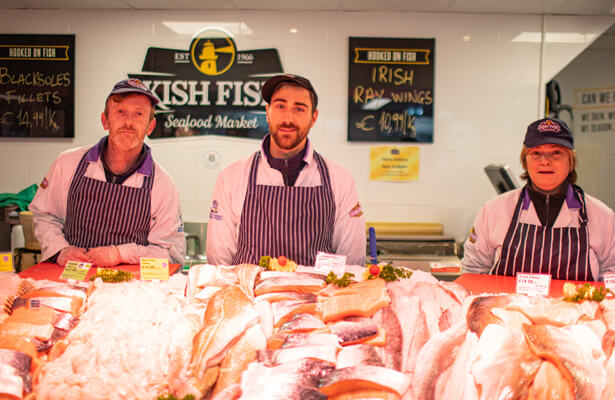 Three Kish Fish employees inside the Coolock shop