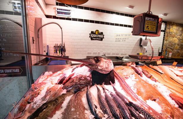 A selection fo fresh fish inside a Kish Fish store